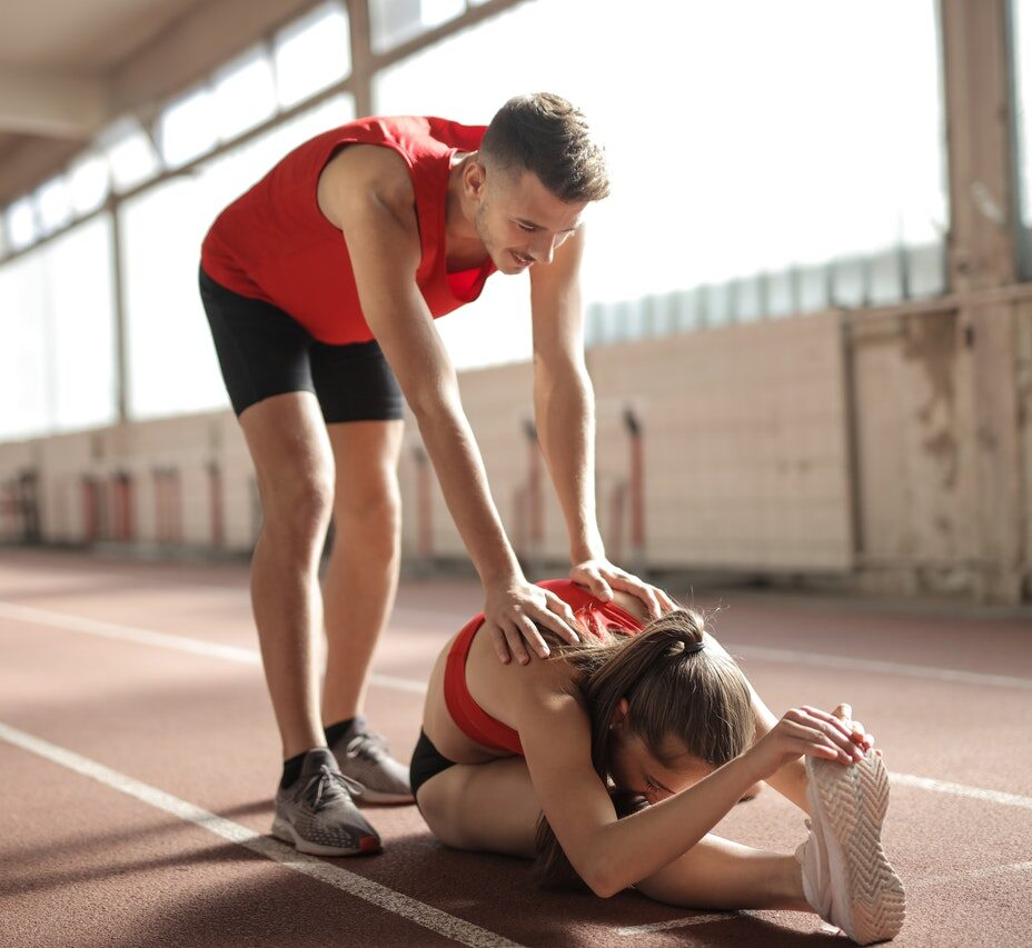 young-athletes-warming-up-on-track-3763864